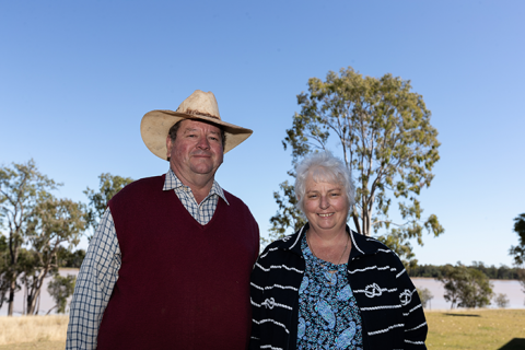 A primary producer husband and wife stand in the garden.