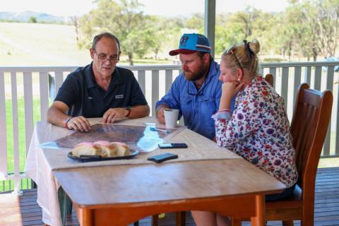 Regional Area Manager for Capricornia, John Metelli talks with QRIDA clients Matt and Kristie Lisle over dinner table