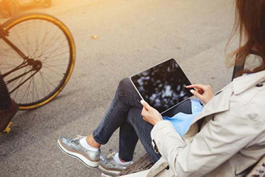 Girl sitting, using iPad